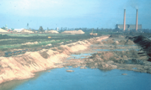 Gravel Extraction, northern pits, 1950s and 1960s Goldington Power Station in the background in operation (Photograph supplied by Nick Hall, Conservation Officer, Bedford Borough Council)